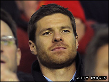Xabi Alonso watches his former Liverpool team-mates