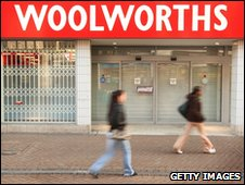 Shoppers walk past closed Woolworths branch