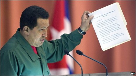 Venezuelan President Hugo Chavez reads out a letter from Fidel Castro at the Alba summit