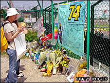 A fan pays her respects to Kato at the Suzuka circuit
