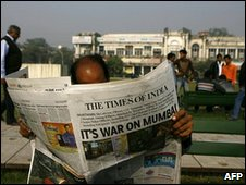 A man reads the Times of India the day after the Mumbai attacks