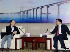 "Hong Kong's Chief Executive Donald Tsang (L) and China""s Vice Premier of the State Council Li Keqiang underneath an illustration of the bridge - 15 December 2009"