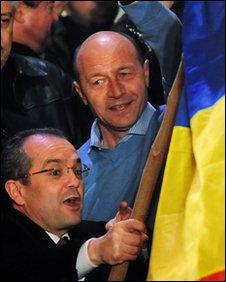 Emil Boc (left) and Traian Basescu, file pic