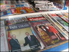 Covers at a newspaper stand