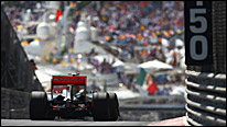A McLaren plunges down towards the chicane with the harbour as its backdrop at Monaco in 2009