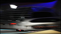 A McLaren passes under the Yas Hotel at the lavish new Abu Dhabi F1 track