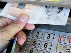 Money being withdrawn from cash machine