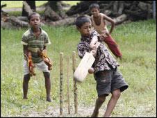 Children playing cricket  at Sreepur Village