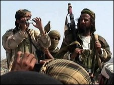 Men claiming to be al-Qaeda members address a crowd gathered in Abyan, Yemen, December 2009