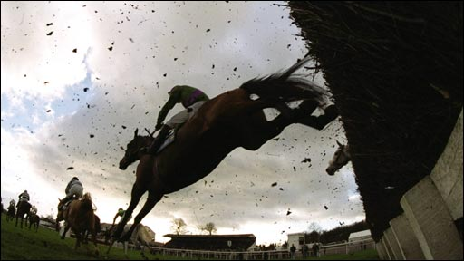 A runner clears a fence at Chepstow