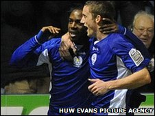 Dany N'Guessan celebrates his late winner with fellow goal scorer Andy King