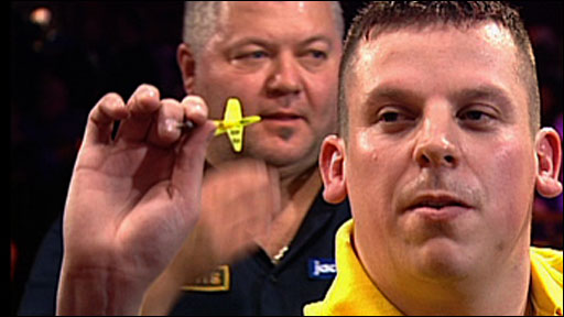 Dave Chisnall in action against Darryl Fitton