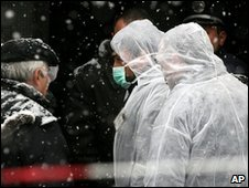 Bulgarian police speak to witnesses at the site where Tsankov was killed, Sofia, Bulgaria, 5 January 2010