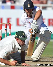 England's Jonathan Trott plays a defensive shot during the final session in Cape Town