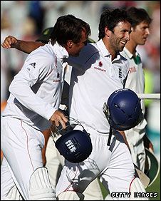 Graeme Swann and Graham Onions celebrate as England grab their draw