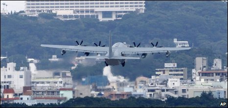 A US military cargo plane takes off from Marine Corps Air Station Futenma in Ginowan, Okinawa, Japan - 17 December 2009