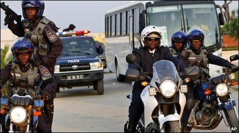 Police escort the Ivory Coast soccer team from their compound in Cabinda, Angola