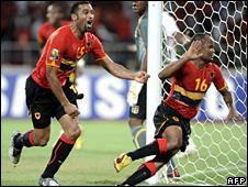 Flavio (right) celebrates scoring