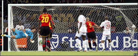 Angola's goalkeeper, Fernandos Carlos, dives as Mali's Seydou Keita scores a third goal