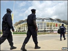 Angolan policemen patrol outside of Chiazi stadium in Cabinda, 11/01