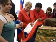 Chilean President Michelle Bachelet (in red) and Kawesqar descendants