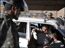 A Yemeni soldier searches for weapons in a vehicle at the check point in Sanaa. Photo: 13 January 2010