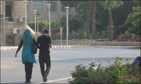 Young man and woman walking in the grounds of Cairo university