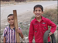 Boys playing happily outdoors in northern Iraq