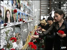 People commemorating the fifth anniversary of the 2004 massacre inside the Beslan school gymnasium