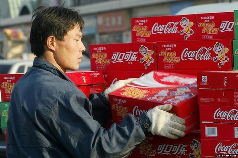 Man unloading cans of coke