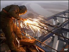 A worker welds on the Yellow River railway bridge, central China