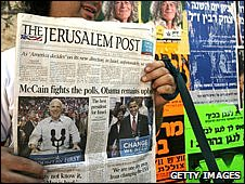 An Israeli holds the Jerusalem Post newspaper