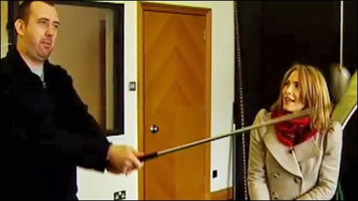 Snooker's Mark Williams shows reporter Lisa Rogers how to drive a golf ball