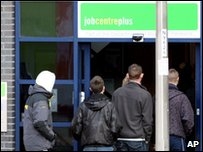 People queuing outside a Jobcentre plus office