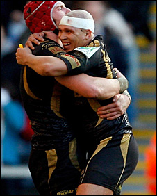 Ospreys Ricky Januarie and Alun Wyn Jones celebrate victory