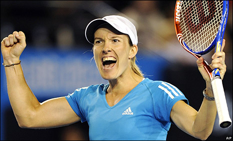 Justine Henin celebrates victory