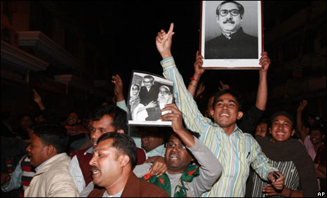 Cheering supporters carry a portrait of Mujibur Rahman outside the Dhaka central jail on Jan 28, 2010