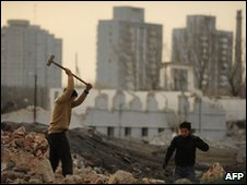 Workers demolishing a building in Beijing to make way for redevelopments