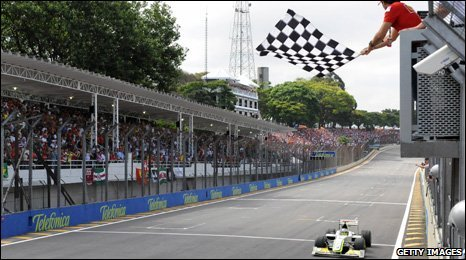 Jenson Button gets the chequered flag
