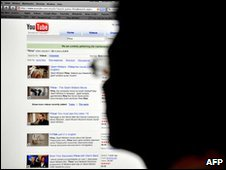 Man searching YouTube, generic