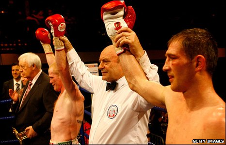 Jason Cook (left) and Lenny Daws each have their hands raised after battling to a draw in their British light-welterweight fight at the York Hall, champion Daws retaining his belt