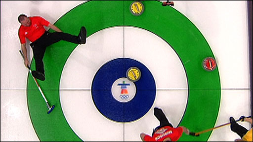 Great Britain curler Euan Byers loses his footing on the ice