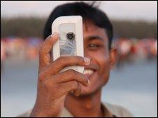 Bangladeshi man with a mobile