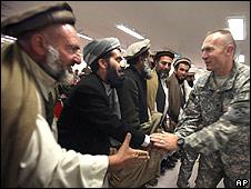 A US. Army official greets Shinwari tribal leaders in Jalalabad