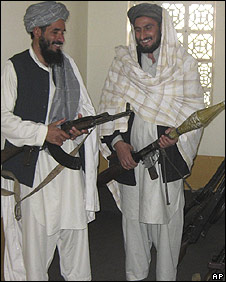 Former pro-Taliban fighters Qari Mohebulla (R) and Fazel Rahman Farouqi (L) handing over weapons