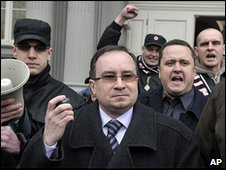 Head of the Czech Workers' Party Tomas Vandas (centre) outside court, 17 February 2010