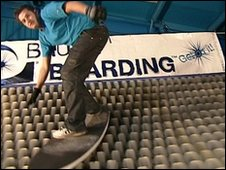 A man brush boarding