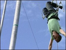 Mike Bushell learns how to fly through the air on a trapeze.