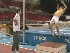 Mike Bushell tries the high jump