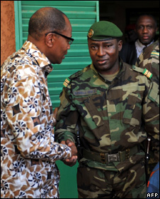 Mohamed Ibn Chambas (left) shakes hands with Col Djibrilla Hima Hamidou